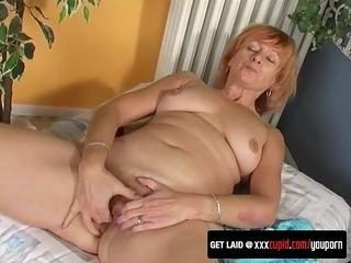 grandma fingers her hairy pussy