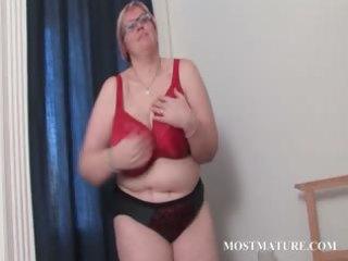 older big beautiful woman in glasses works her
