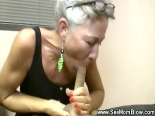 Hungry granny sucking on cock for this lucky guy