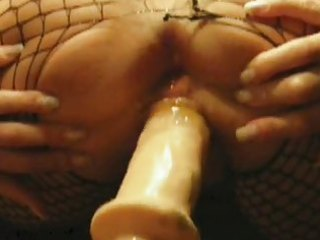 older gets very juicy while dildoing from behind