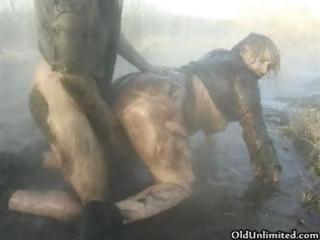 dirty old mommy overspread with mud gets part1