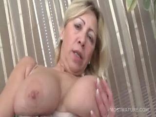 mature tramp in stockings gratifying pussy