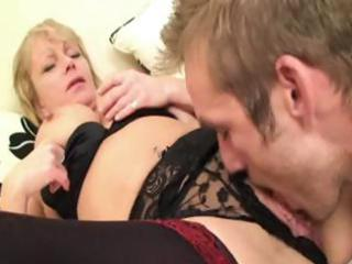 short-haired mature blond crawls in with a young