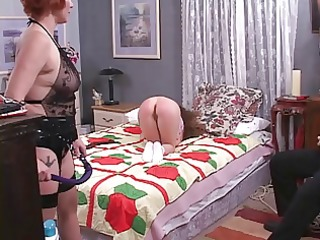 cute lesbo mistresse spanks the hell out of a