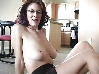 sporty breasty redhead momma works on her dick