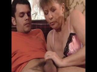 Hot looking granny sucks a younger cock and then