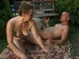 lusty unshaved granny enjoying sex with a guy