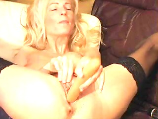 mature golden-haired plays with large toy