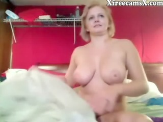 older blond honey with big love melons on livecam