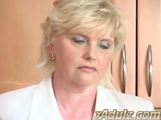 horny blond granny in the kitchen masturbates to