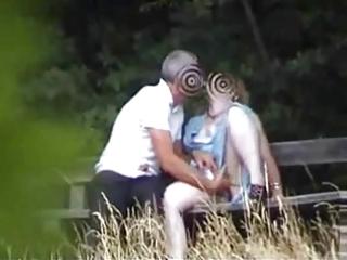 mom in the garden having pleasure with boy ally
