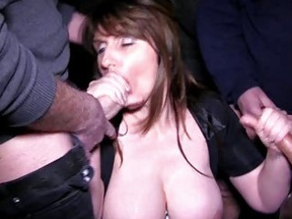 Busty brunette milf gets into a bukkake session