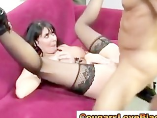 brunette hair cougar in stockings receives a