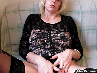 lascivious grandma in nylons fists her shaggy cunt