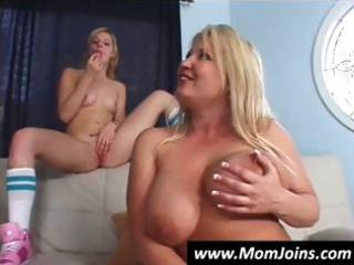 mother and daughter take turns blowing this lad