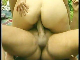 big-tit granny fucks a large penis outdoors