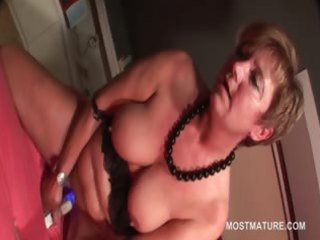 excited older blond self fucks with sextoy